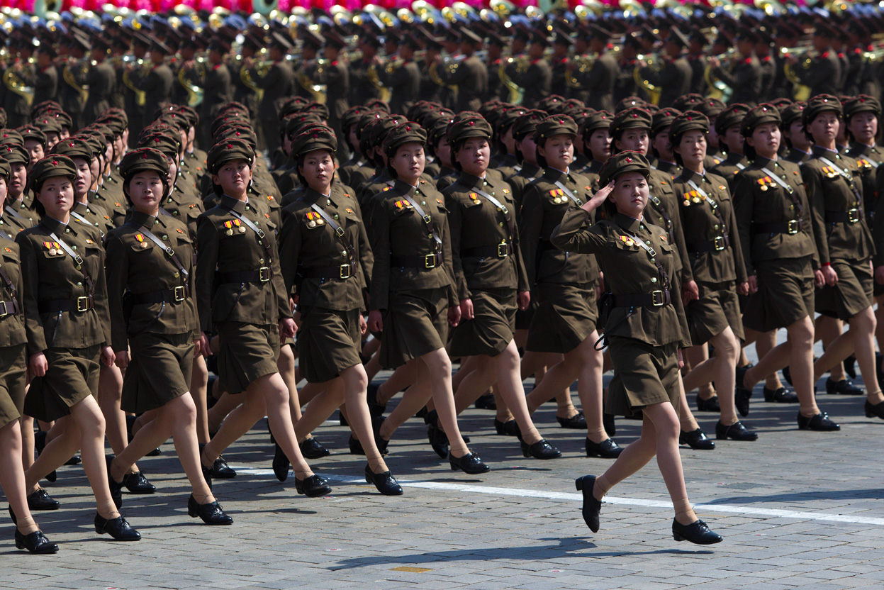 An army of homegrown North Korean members of the LCWR prepare to be strapped to Missles.